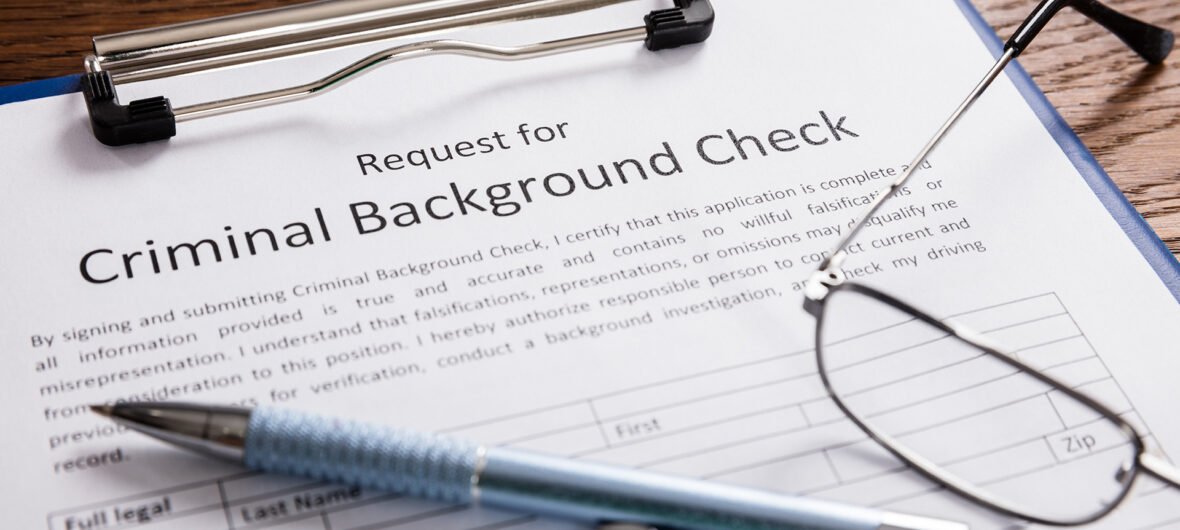 """clipboard with page titled, """"Criminal Background Check Request"""""""